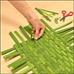 Photograph showing step 4 of how to make a woven bulrush mat