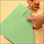 Photograph showing step 2 of how to make an origami box