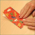 Photograph showing step 4 of how to make an origami box