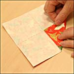 Photograph showing step 7 of how to make an origami box