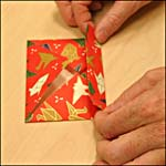 Photograph B showing step 9 of how to make an origami box