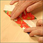 Photograph showing step 11 of how to make an origami box