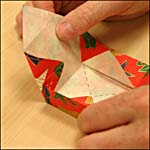 Photograph showing step 12 of how to make an origami box