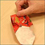 Photograph A showing step 13 of how to make an origami box