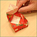 Photograph showing step 14 of how to make an origami box